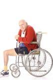 Bejaarde handicapmens in rolstoel Stock Afbeelding