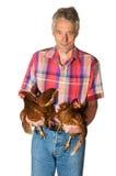 Bejaarde landbouwer met kip Royalty-vrije Stock Foto