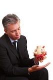 Bejaarde manager met lege piggy Royalty-vrije Stock Fotografie