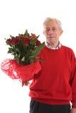 Bejaarde met bloemen Royalty-vrije Stock Foto