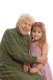 Bejaarde met de kleindochter Stock Foto's