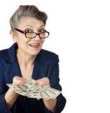 Bejaarde met dollars stock foto's