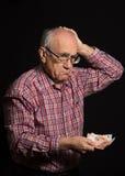 Bejaarde met geld royalty-vrije stock foto