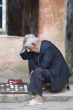 Bejaarde Vietnamese Mens die Saigon spelen Royalty-vrije Stock Foto