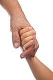 Bejaarden en jonge handen Stock Foto's