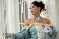 Bejeweled Asian Woman in Elegant Dress Stock Image