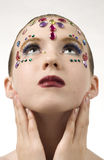 Bejewled Beauty. Young girl with jewels on her face Stock Photography