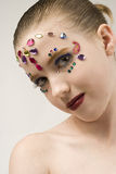 Bejewled Beauty. Young girl with jewels on her face Royalty Free Stock Image