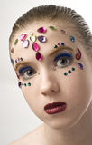 Bejewled Beauty. Young girl with jewels on her face Stock Images
