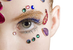 Bejewled Beauty. Young girl with jewels on her face Royalty Free Stock Photo