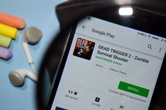DEAD TRIGGER 2 - Zombie Survival Shooter dev app with magnifying on Smartphone screen. BEKASI, WEST JAVA, INDONESIA. DECEMBER 27, 2018 : DEAD TRIGGER 2 - Zombie stock photography