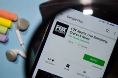 FOX Sports: Live Streaming, Score & News dev app with magnifying on Smartphone screen royalty free stock image