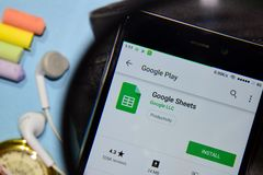 Google Sheets dev app with magnifying on Smartphone screen. BEKASI, WEST JAVA, INDONESIA. DECEMBER 20, 2018 : Google Sheets dev app with magnifying on Smartphone stock photo