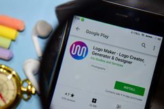 Logo Maker - Logo Creator, Generator & Designer dev app with magnifying on Smartphone screen. BEKASI, WEST JAVA, INDONESIA. DECEMBER 25, 2018 : Logo Maker stock image