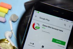 Opera Mini browser beta dev app with magnifying on Smartphone screen royalty free stock photo