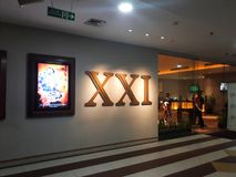 XXI cinema inside a shopping mall. 21 Cinemas is the second largest cinema chain in Indonesia. BEKASI, WEST JAVA, INDONESIA. JUNE 15, 2019: Unrecognize people royalty free stock photo