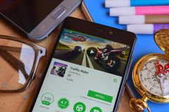 Traffic Rider dev app on Smartphone screen. BEKASI, WEST JAVA, INDONESIA. SEPTEMBER 2, 2018 : Traffic Rider dev app on Smartphone screen. Traffic Rider is a stock images