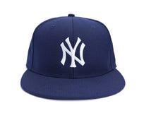 Bekläda beskådar av New York Yankees klumpa ihop sig locket Arkivfoto