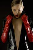 beklär den slitage kvinnan för latexen Fotografering för Bildbyråer