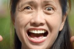 Beklemtoond Ouder Filipina Person royalty-vrije stock afbeelding