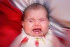 Beklemtoonde Baby Stock Foto