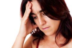 Beklemtoonde Spaanse vrouw met een hoofdpijn Stock Fotografie