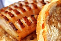 Bekon ciący z chlebem Obrazy Stock