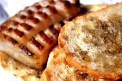 Bekon ciący z chlebem Fotografia Stock