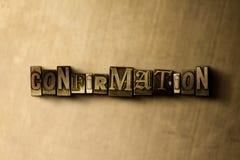 BEKRÄFTELSE - närbild av det typsatta ordet för grungy tappning på metallbakgrunden stock illustrationer