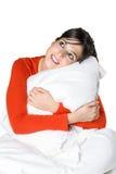 Bekväm lycklig kvinna i den isolerade sängen Royaltyfri Fotografi