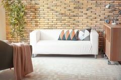 Bekväm soffa med kuddar Royaltyfri Fotografi