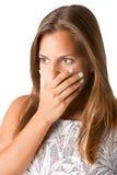Bekymrad kvinnabeläggningmun Arkivfoton