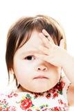 Bekymrad liten flicka arkivfoto