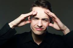 Bekymrat eller ha en huvudvärk royaltyfri bild
