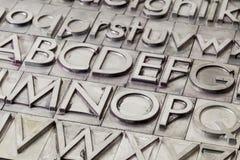 Belägga med metall alfabetabstrakt begrepp Fotografering för Bildbyråer