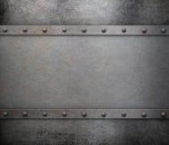 Belägga med metall bakgrund med rivets Arkivfoton