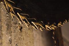 Belägga med metall cirkelsågbladet. Abctract foto. arbete bearbetar Royaltyfri Foto