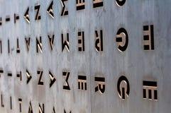 Belägga med metall dörren med hålen i formen av bokstäver Royaltyfri Foto