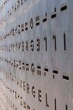Belägga med metall dörren med hålen i formen av bokstäver Royaltyfri Bild