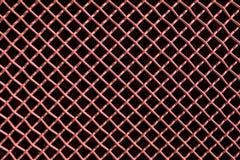 Belägga med metall ingrepps- eller aluminiumrastret på svart bakgrund arkivbilder