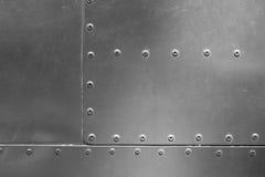 Belägga med metall pläterar med Rivets Arkivfoto