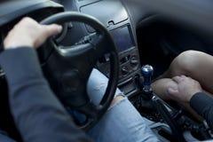 Belästigung im Auto. Lizenzfreie Stockbilder