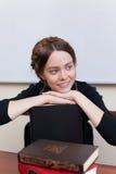 Bel étudiant féminin avec des livres Image stock