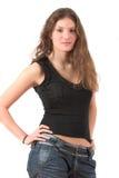 Bel adolescent restant avec des mains sur ses gratte-culs image stock