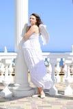 Bel enceinte avec une fille avec des ailes Image stock