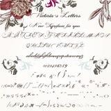 Bel oeil d'un caractère fabriqué à la main ou police en manuscrit dans le vintage victorien Photos stock