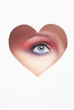 Bel oeil de femme à l'intérieur de coeur Photographie stock libre de droits