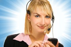 Bel opérateur de ligne directe avec le portable dans son h Image libre de droits