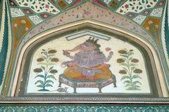 Bel ornement sur le mur du palais en Amber Fort à Jaipur Photos libres de droits
