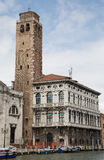 Bel Tower by Old Venice Building Royalty Free Stock Image